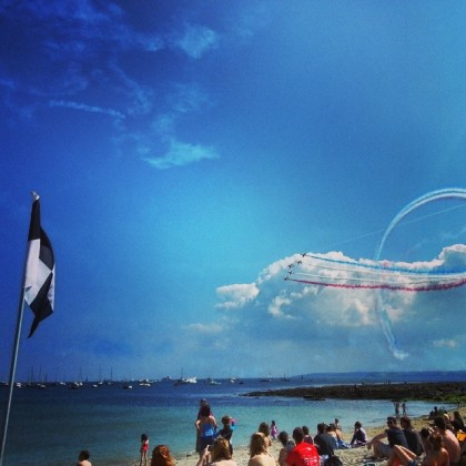 The Red Arrows draw large crowds over Gylly Beach, Falmouth, Cornwall